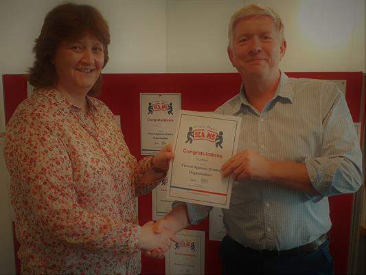 Simon Ayers, CEO of TrustMark with Michele Manson, Business Team Manager of Buckinghamshire and Surrey Trading Standards